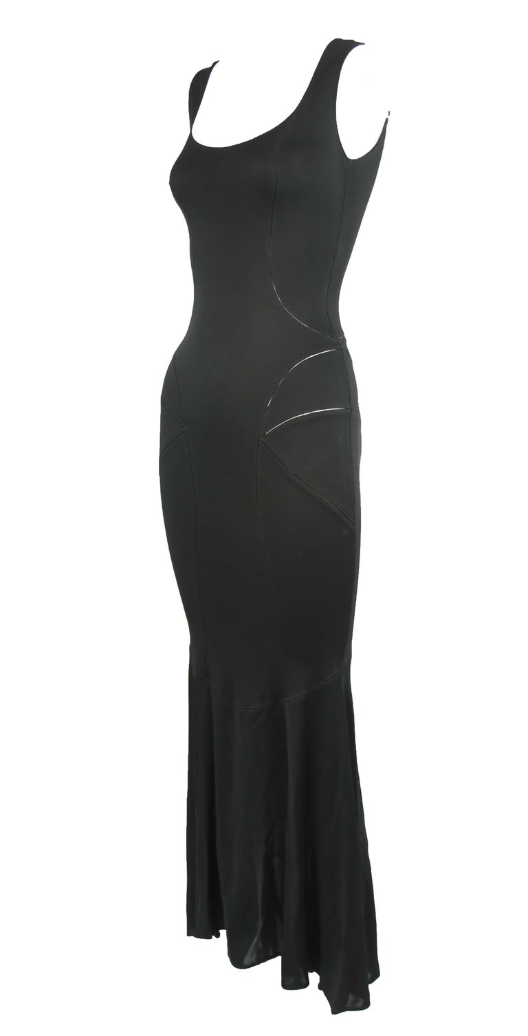 Vintage Alaia sleeveless black tea length gown.  Stunning seams that show a slight bit of skin.  Makes for the perfect wardrobe essential.  Size: S  Condition: Pristine vintage condition  Composition: 100% viscose  Care: Dry clean only  Made in Italy