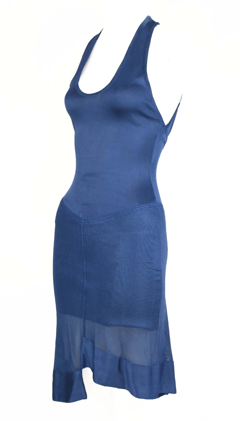 Denim blue vintage Alaia knit dress.  Interesting asymmetrical hem and open back.   Size: Missing size tag but fits XS/S  Condition: Very good vintage condition  Composition: Knit fabric, missing fabric tag