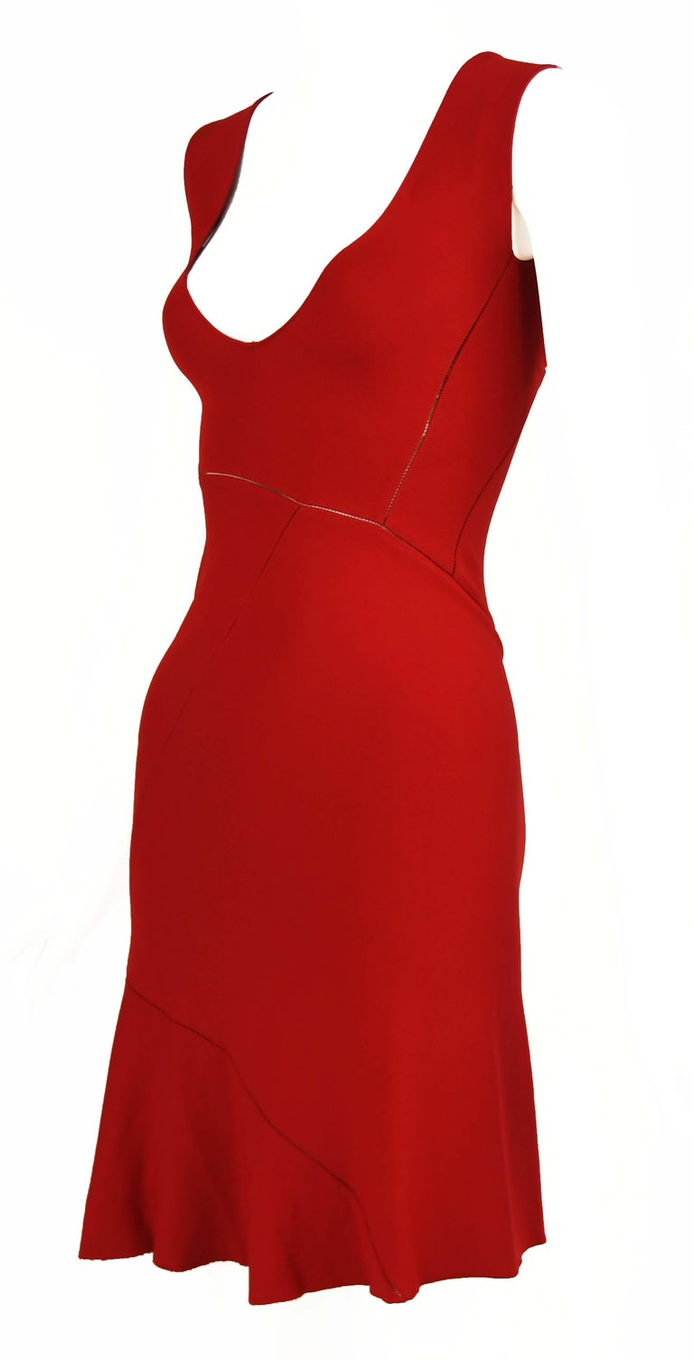 Sleeveless, vintage Alaia red dress featuring asymmetrical seams with a slight peak-a-boo effect.  Sexy v neck and fitted through the bodice.  Size: Size not marked but approximate small  Condition: Excellent vintage condition  Composition: Missing