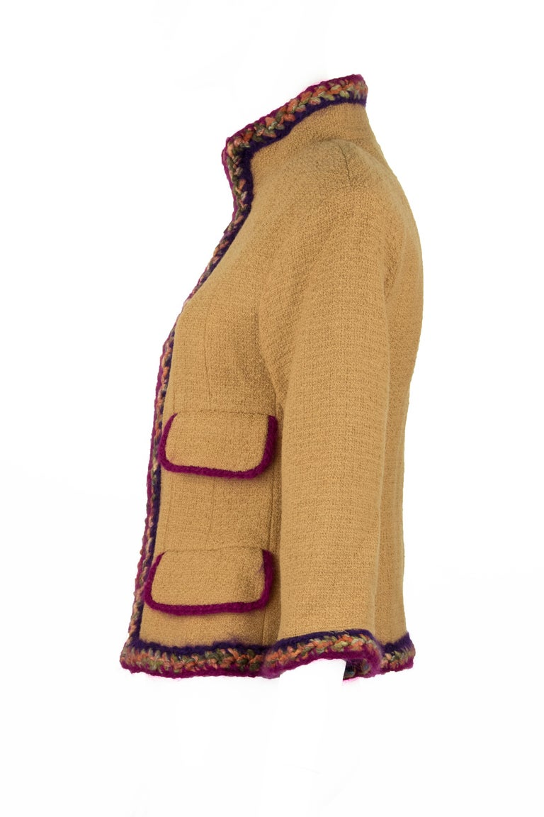 Incredible collectible Chanel jacket made out of a camel wool with multicolored detail trim.  The trim is composed of magenta, purple, a light peach and green yarn.  There is a center front zipper with Chanel logo.  This is an incredible chic jacket