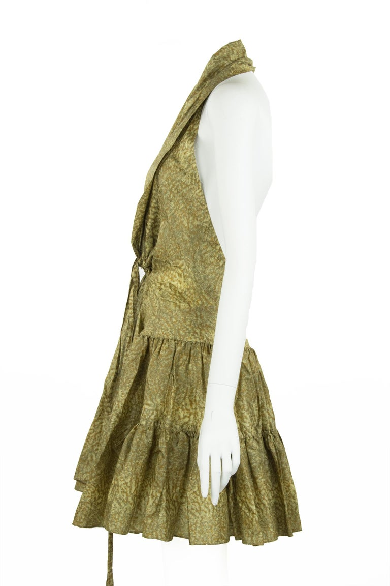 Fun and flirty Alaia printed silk dress in beautiful shades of green and brown.  Features a halter neck and ruffle tiers on the skirt.  Ties in the front.    Size: FR 44  Condition: Excellent condition  Composition: 86% silk, 14% acrylic  Care: Dry