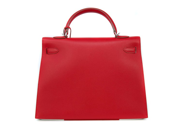 Limited edition Kelly flag bag that is no longer in production.  Rouge tomate, a stunning rich and deep red, contrasted with bright white.  This is the perfect summer statement bag.  Comes in original box with dustbag, lock & keys, Kelly strap and