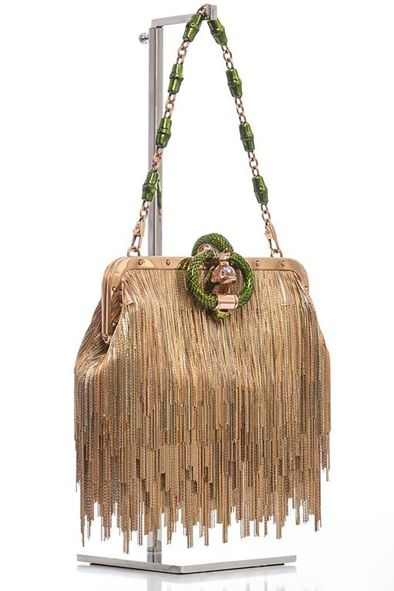 Gucci Evening Bag.  Tom Ford for Gucci, Spring / Summer 2004 Champagne satin, fringe dragon series evening bag with gold-tone hardware, single shoulder strap with bamboo chain-link accent, gold-tone fringe embellishment throughout.  Inside champagne