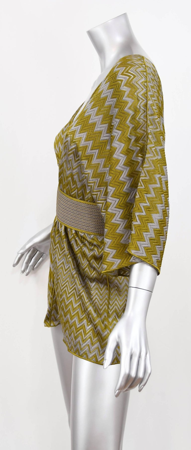 This vacation/resort essential Missoni Zigzag Knit Tunic is crease proof and will take up minimal space in your luggage.  Wear over a swimsuit or leggings for a chic look.  It has Dolman sleeves and includes a matching belt to cinch the waist.  One