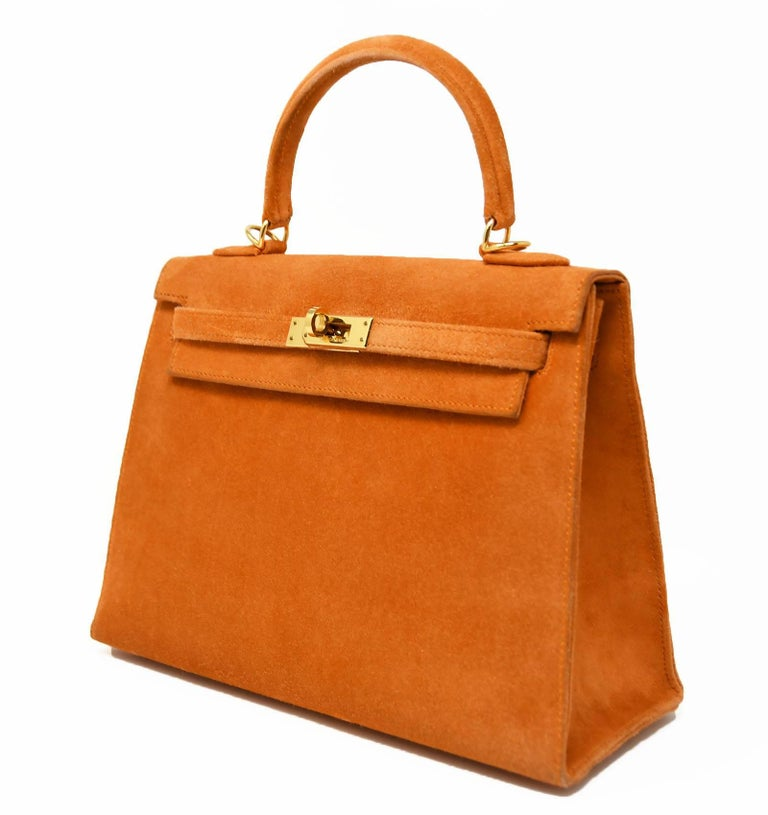 Rare suede kelly bag in a signature Hermes orange with gold hardware.  This bag is used but in good condition and comes with the Hermes dust cover.  Do not miss out on this opportunity to own a coveted suede Kelly bag.