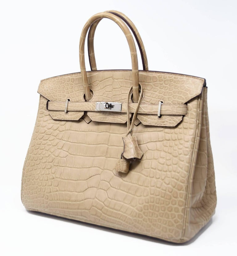 Extremely rare Hermes Birkin in Natural Matte Alligator with Palladium hardware. New with Plastic on hardware. Fabulous all year round. Includes the original Hermes box with sleepers, raincoat, lock keys and clochette.  Crafted in matte Poussiere