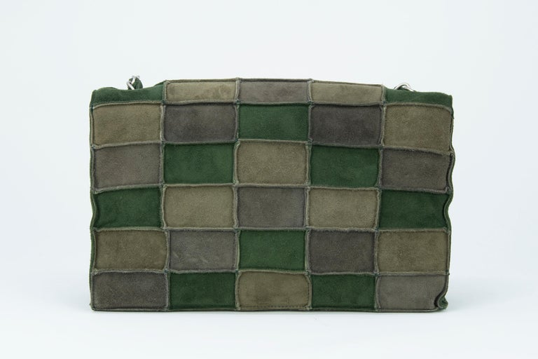 Incredible and unique Chanel medium double flap bag made of green patched suede.  An incredible color palette for fall.  Features silver hardware and a long chain strap.  Condition: New  Dimensions (Approximate): 9.5