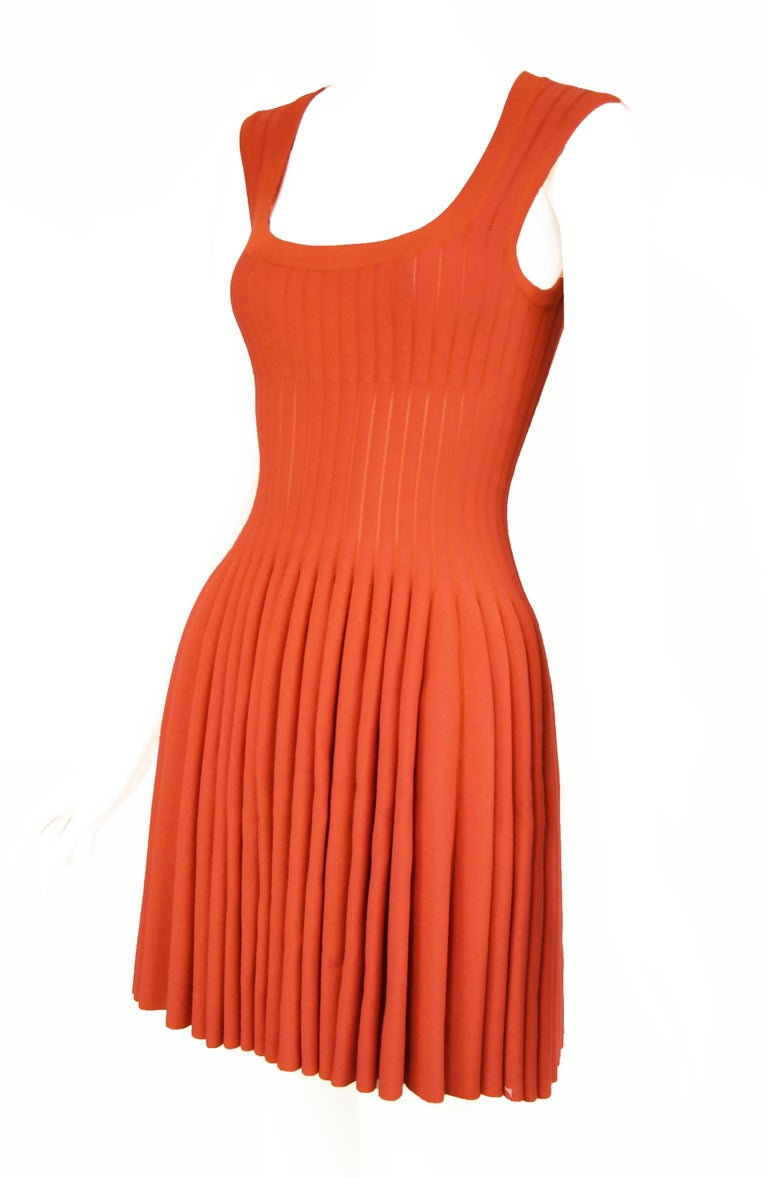 Gorgeous dark coral Alaia fit and flare dress.  Slightly sheer knit between the ribs (see last photo) gives this dress interesting detail and texture.  Beautiful square neckline, classic Alaia dress in stunning color.  Size: FR 38  Condition: