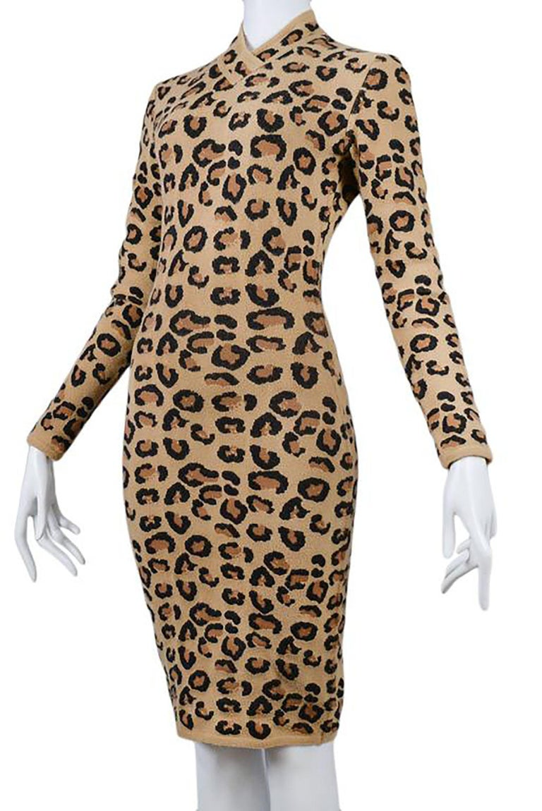 Incredibly rare and coveted 1990s vintage Alaia v neck dress.  From one of his most famous collections, worn by top celebrities and supermodels.  Collectors- this is a rare piece, do not miss out on this opportunity.  Fitted throughout and length is