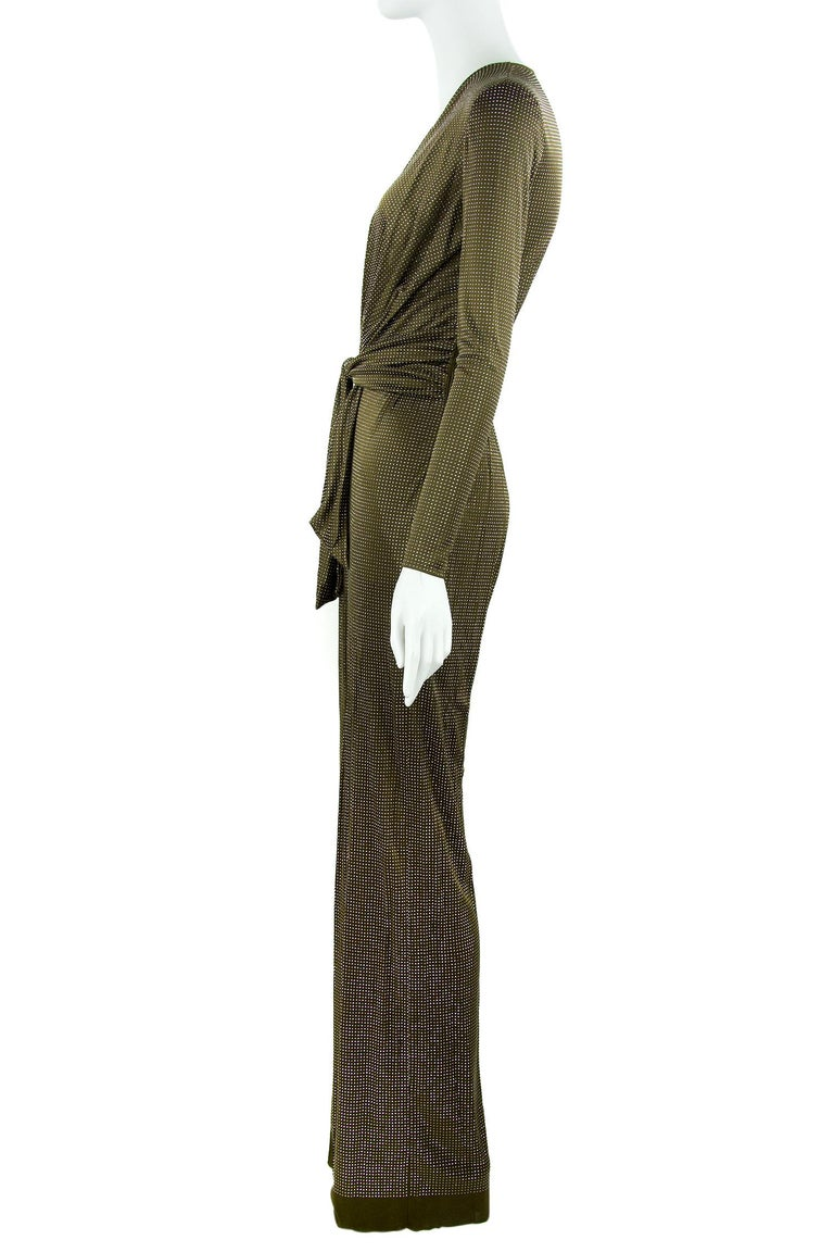 Incredible Emilio Pucci stretch knit jumpsuit that brings back a taste of the 70s.  Features a plunging v neck with a gathered waist and silver beaded brown fabric. Additionally, there are delicate covered buttons on the sleeves. Such a fun look for