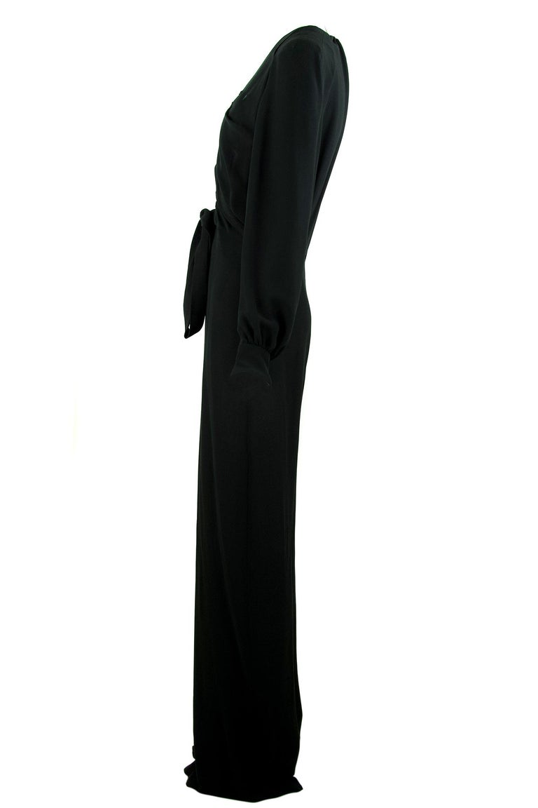 Chic and sexy Chloe long sleeve black jumpsuit.  Features gathered black silk fabric and a very low v neck with a tie at the bottom.  Gathering on the back and at the cuffs.    Size: FR 38  Condition: Pristine  Composition: 100% silk  Care: Dry