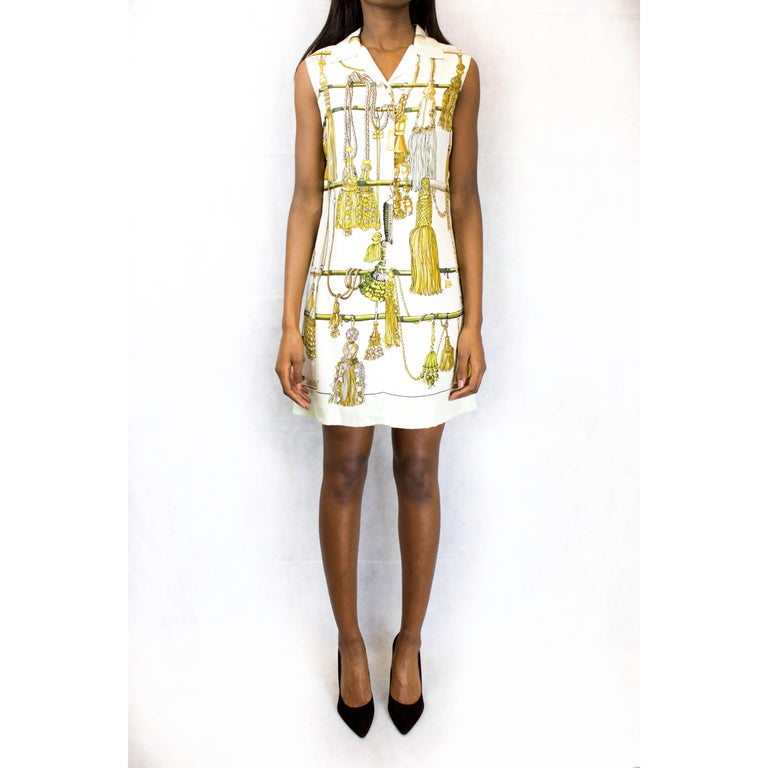 """This dress is a statement piece that embodies the Hermès tradition, luxury and Frenchness. The intricate design """"Passementeries"""", silk-printed by hand on double ply Mulberry silk, was designed by the French artist Francoise Heron in 1960. Featuring"""