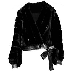 Christian Dior black faux fur and leather trimmed short jacket. circa. 1967