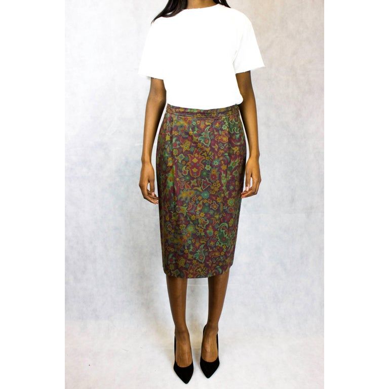 """Recognised under the Saint Laurent Rive Gauche label, this straight line """"peg-leg"""" pencil skirt was designed and made circa late 1970. Constructed from cotton with a luxurious wax finish, the skirt has a camouflage inspired paisley print giving the"""