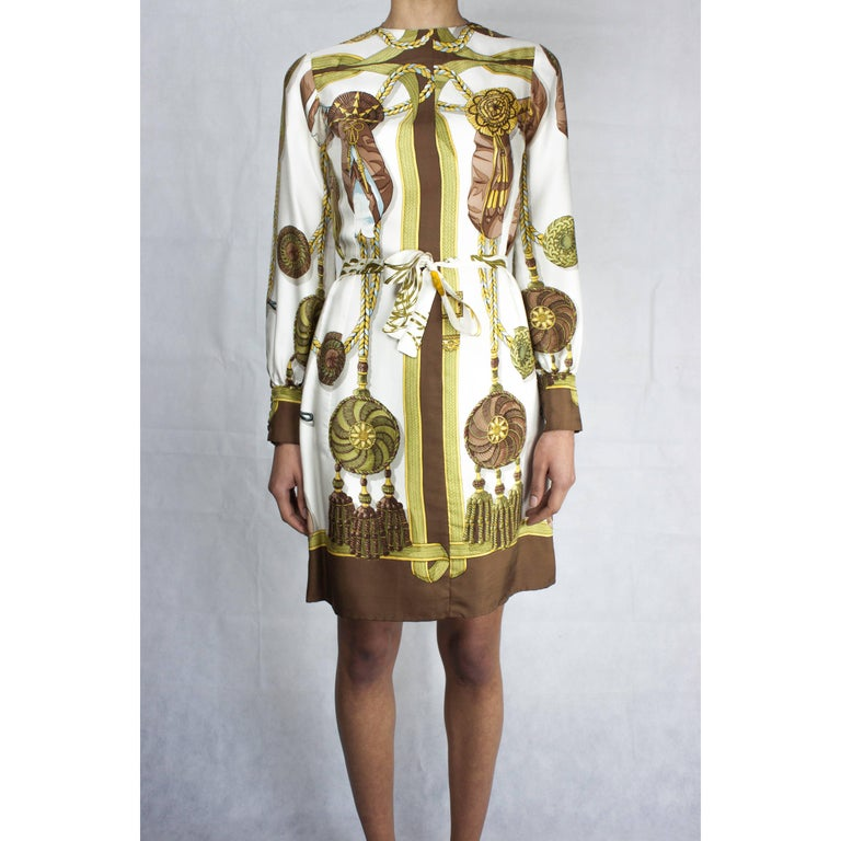Since 1937, Hermès has called upon artists to create art on silk for their scarves, shirts and other signature pieces.  The print for this elegant dress was conceived by the French artist Cathy Latham.  For over forty-five years Latham has designed