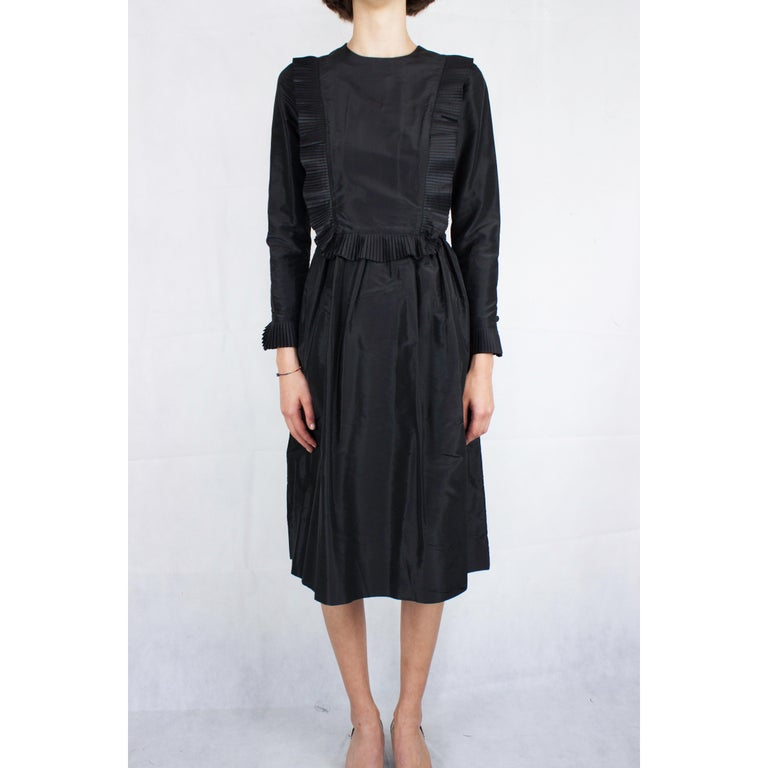 """In 1926 Chanel creates the """"little black dress"""". The simple dress signalled an important marker in women's fashion and today it remains as one of the most valued and iconic fashion designs of the twentieth century.  This Chanel little black dress"""