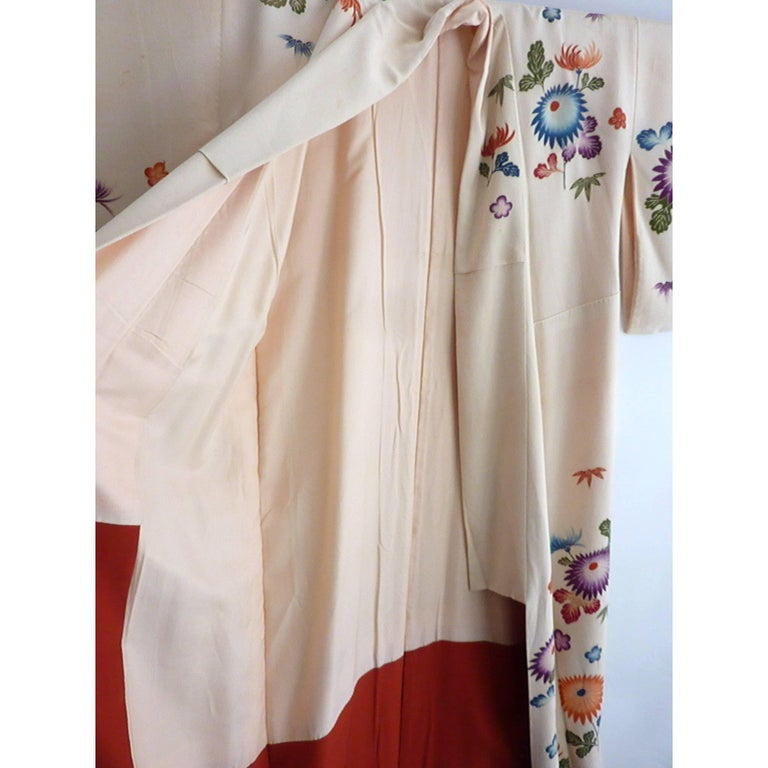 "Circa: 1920-1930 Place of Origin: Japan Material: Silk Condition: Good Ecru color floral all silk kimono hand-painted, hand-sewn and made in Japan. Some water stains but in overall condition. The total length 54"", with the underarm circumstance"