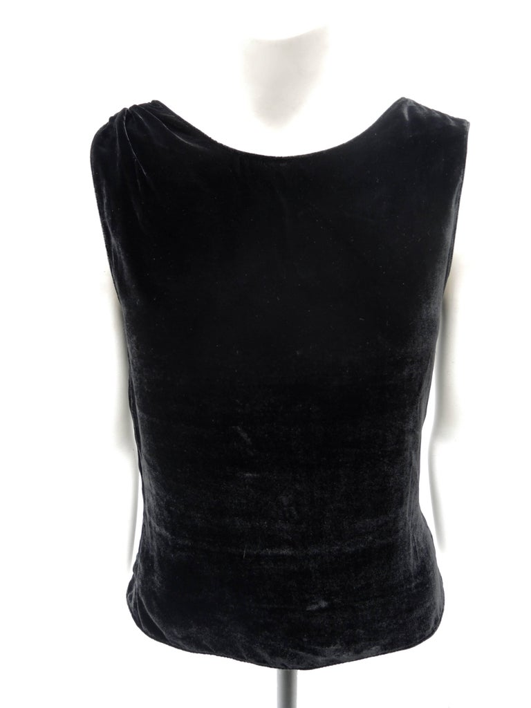 The perfect go-to top to wear alone or under a jacket. This silk and rayon black velvet top has a concealed side zipper for a figure flattering nipped waist ,and a covered velvet link detail highlighting one shoulder. Simple, timeless with just the
