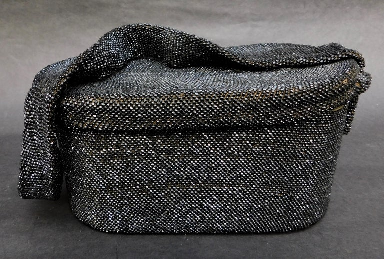 1940's Evening Bag in an oval box shape with attached lift up top fully hand beaded in tiny black jet glass seed beads. A very special statement piece to add that certain je ne sais quoi to your ensemble day or night
