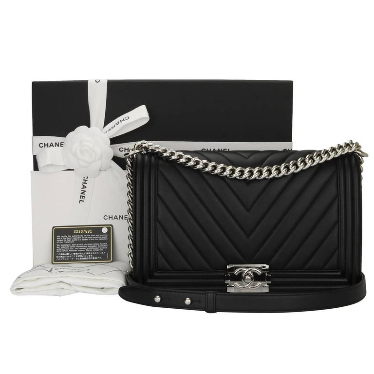 f525bf294076 Authentic Chanel New Medium Chevron Boy Black Calfskin with Shiny Silver  Hardware 2016. This stunning