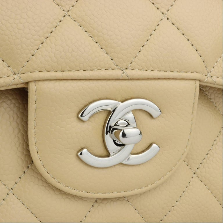 Authentic CHANEL Classic Double Flap Jumbo Beige Clair Caviar with Silver Hardware 2013.  This stunning bag is in mint condition, the bag still holds the original shape and the hardware is still very shiny.  Exterior Condition: Mint condition, tiny