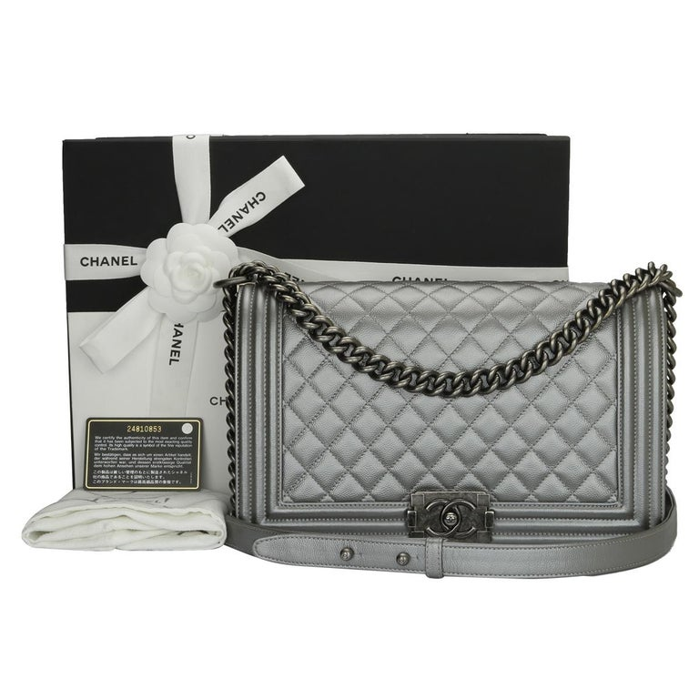 Authentic CHANEL New Medium Quilted Boy Silver Grey Caviar with Ruthenium Hardware 2018.  This stunning bag is still in a mint condition; it still keeps its original shape and the hardware still very shiny, leather smells fresh as if new.  Exterior