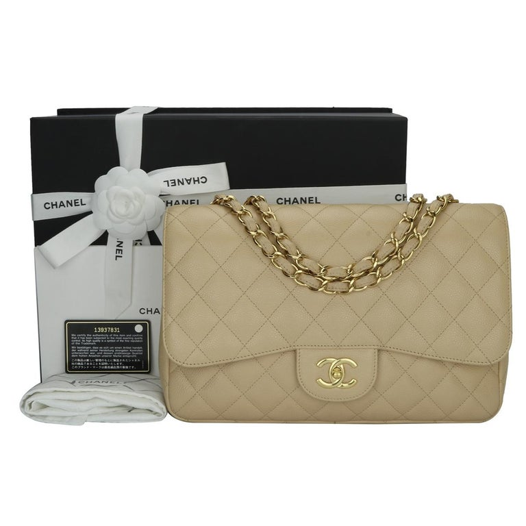 Authentic CHANEL Classic Single Flap Jumbo Beige Clair Caviar with Gold Hardware 2009.  This stunning bag is in excellent condition, the bag still holds the original shape and the hardware is still very shiny.  Exterior Condition: Mint condition,