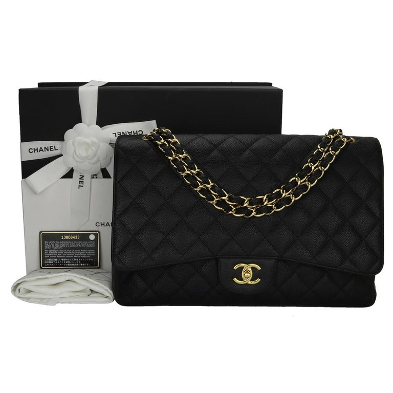 Authentic CHANEL Black Caviar Maxi Single Flap with Gold Hardware 2009.  This stunning bag is in a mint condition, the bag still holds its original shape and the hardware is still very shiny. Leather still smells fresh as if new.  Exterior