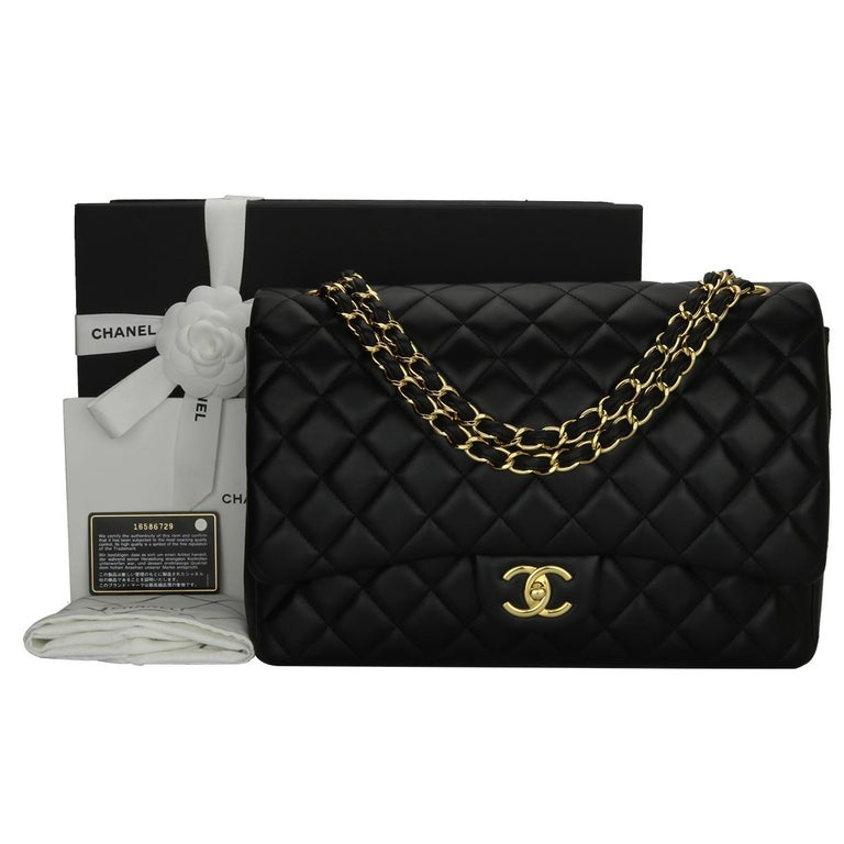 Authentic CHANEL Black Lambskin Maxi Double Flap with Gold Hardware 2012.  This stunning bag is in a pristine condition, the bag still holds its original shape and the hardware is still very shiny. Leather still smells fresh as if new.  Exterior