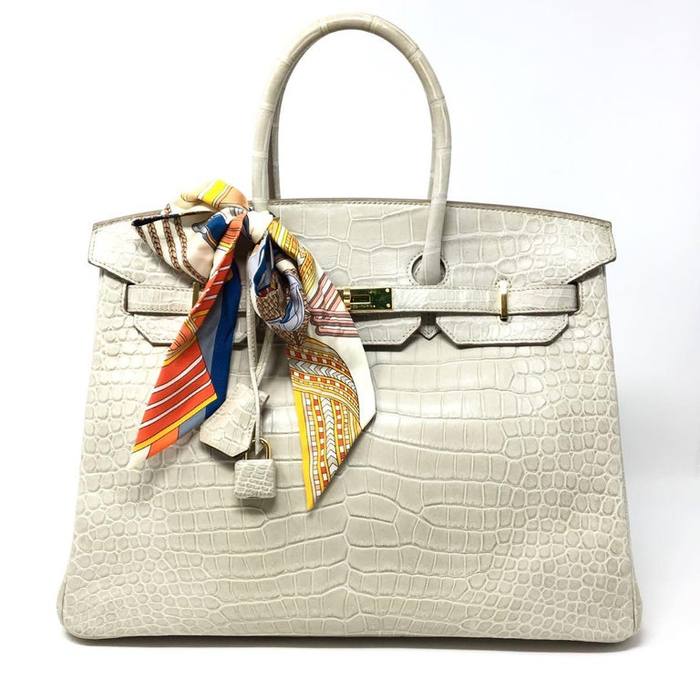 Hermes Paris Sac Birkin 35 Special Order, this exclusive Hermes Bag, made of alligator leather that contributes to its luxurious design. The Gris Fonce Chevre Leather Inside. The bag is an amazing and Rare piece of 2015 in the exotic alligator