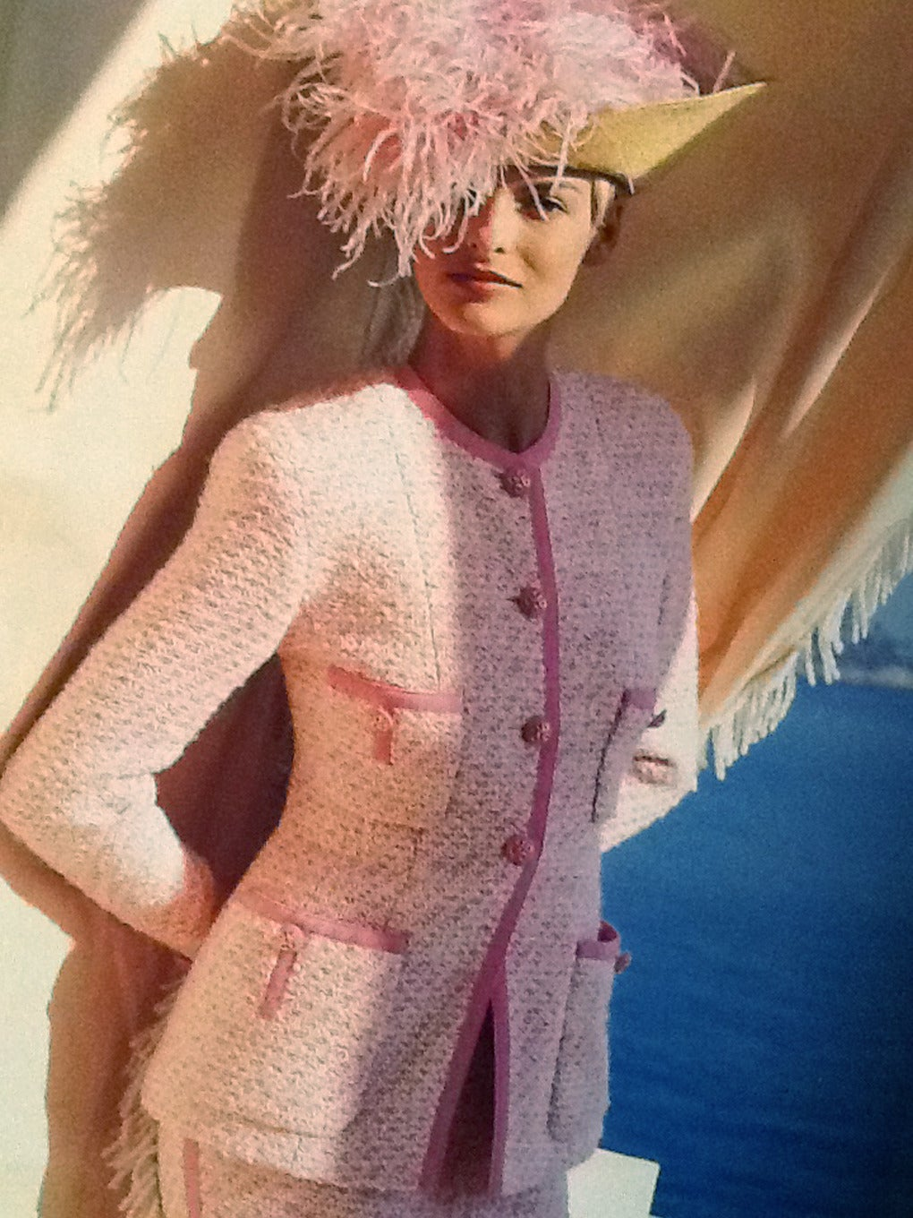 Chanel suit in pink and creme . Documented with Chanel catalogue picture. Size EU 38 Measurements: Jacket: Length 27