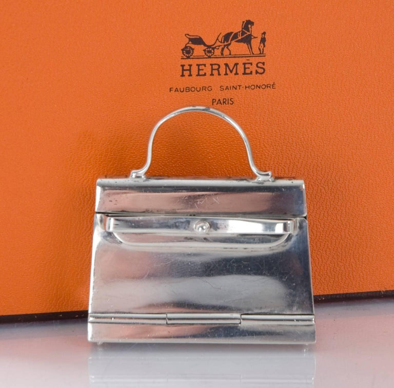 HERMES Paris Pill Box in  925 Sterling Silver styled as a 'Kelly' Handbag.  Opens by pull towards front. Silver Stamp is located inside on the bottom. No original packaging,but comes in a small Hermes box. Some small scratches and marks and the