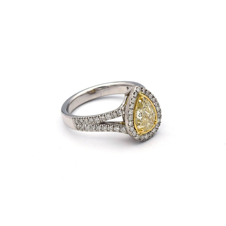 cfe00083f477e7 This Pear Shaped Natural Yellow Diamond weights 1.00ct, along with 59 White  Pave Diamonds