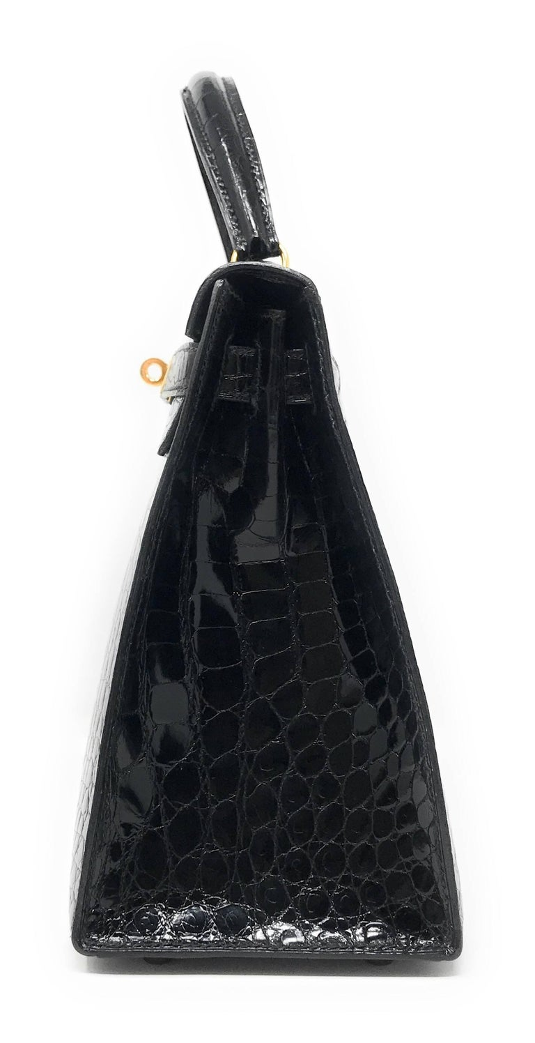 The Holy Grail bag of most collectors, the Hermes Kelly in Black Shiny Alligator.  This handbag is the 28cm size which is one the most sought after size.  It is crafted in the Sellier style which is top stitched and will maintain it's rigid