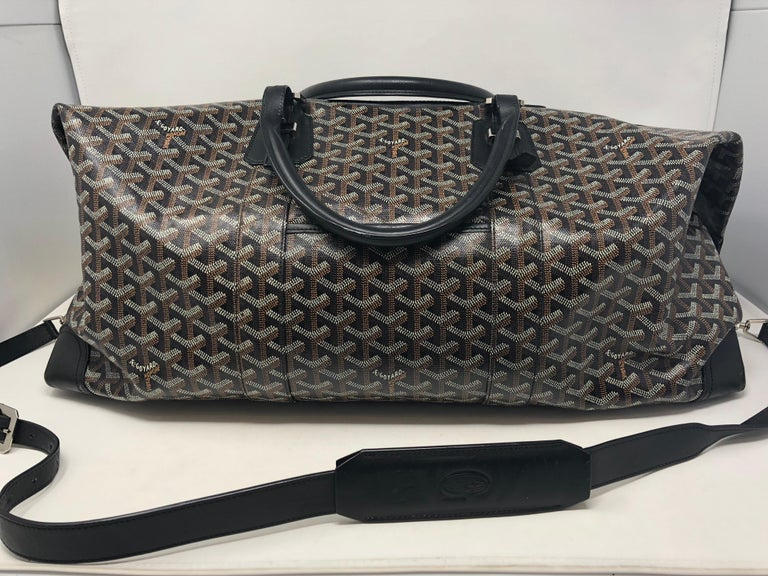 Goyard 55 Duffel Bag comes with strap. Largest Carry on size. Good condition, some wear inside spots and slight dirt. Hard to find and great travel bag. Celebrity owned. Guaranteed authentic.