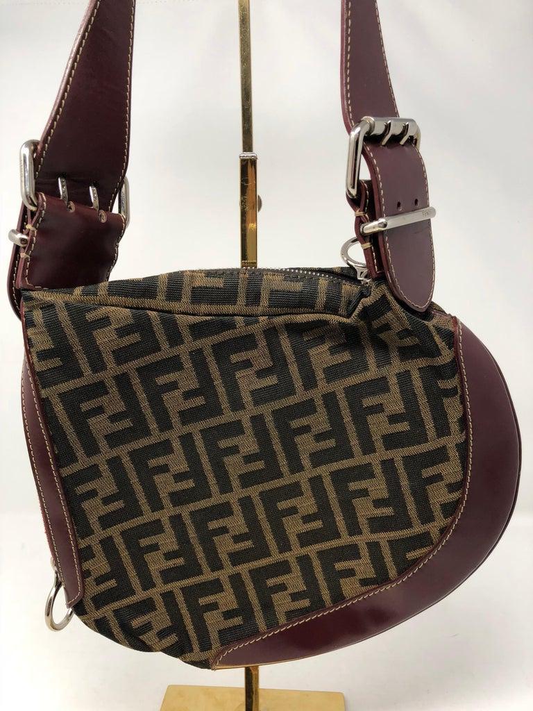 Fendi Monogram Saddle Bag With Leather Trim Burgundy Handle And Around The