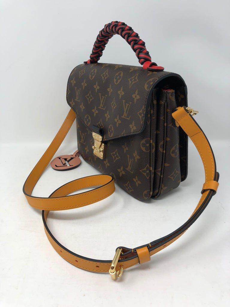 5c5255070d22 Louis Vuitton Pochette Metis Limited Edition Braided Handle coated with red  and brown leather. Beautiful