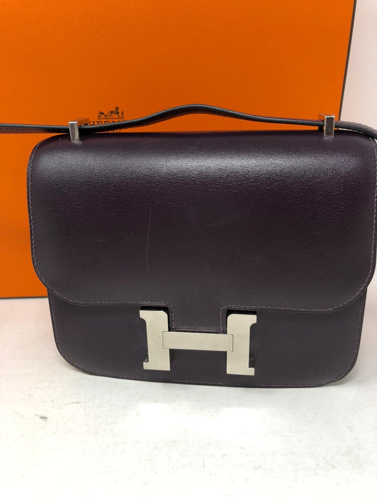 Hermes Constance Purple Mini 18 Bag. Dark purple color swift leather. Palladium hardware. Rare hard to find Constance especially in this mini size. Color is rare too. Good condition. Light surface scratches. Bag can worn longer or doubled.