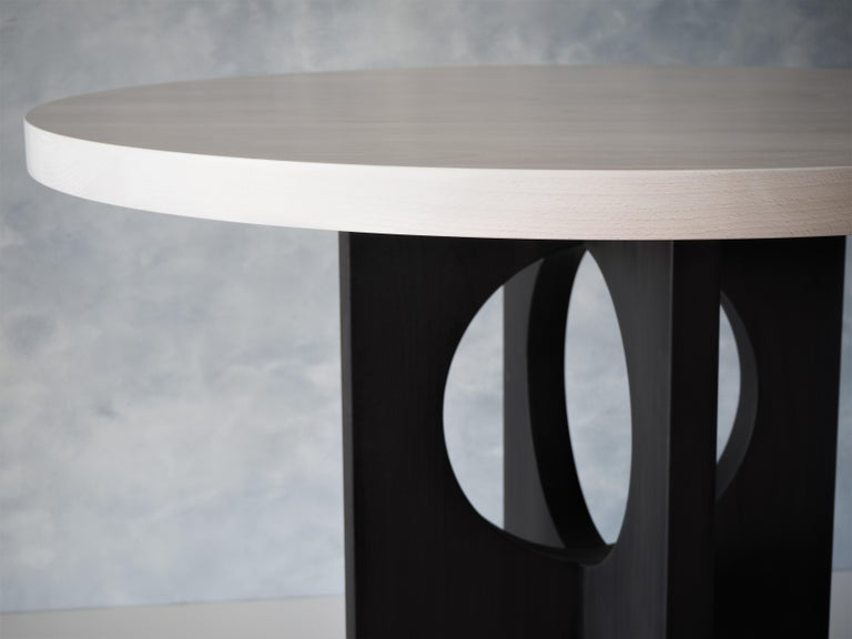Our Archway dining table is designed to bring architectural form to your interior space. With a whitewashed beech table top and India ink beech base, this table will fit in nicely with a variety of decors.  This piece can also be ordered in all