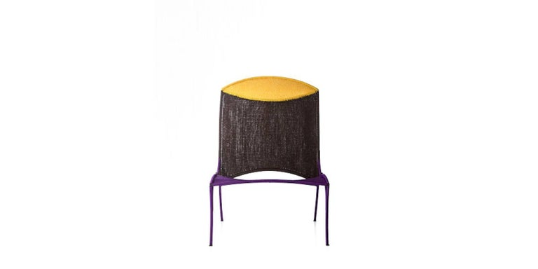 Arco chair B. by Martino Gamper for Moroso for indoor and outdoor in multi-color.  The Arco collection is part of the M'Afrique collection, a range of chairs conceived by various designers and produced by African craft weavers using the yarn of