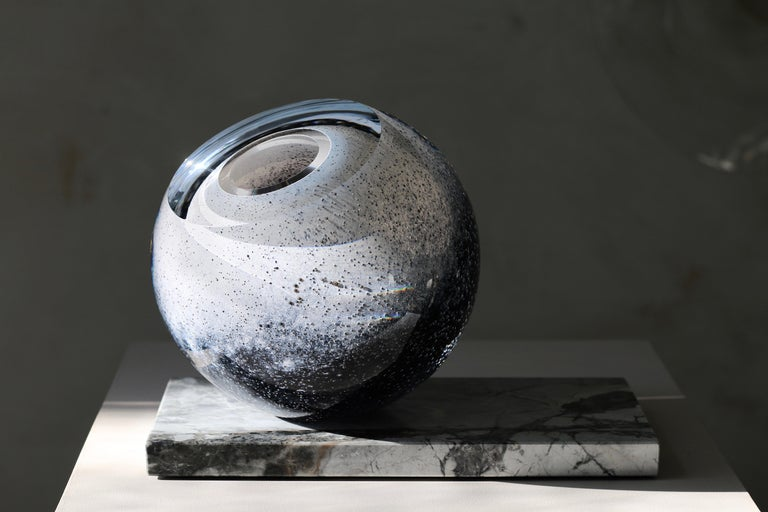 'Arctica' large sculptural vase from collection 'Mother Eternity' in mouth blown glass in dark blue and snow white on Côte d'Azur marble. Handcrafted by a team of skilled craftsmen in highest quality, extra clear glass. A unique piece,