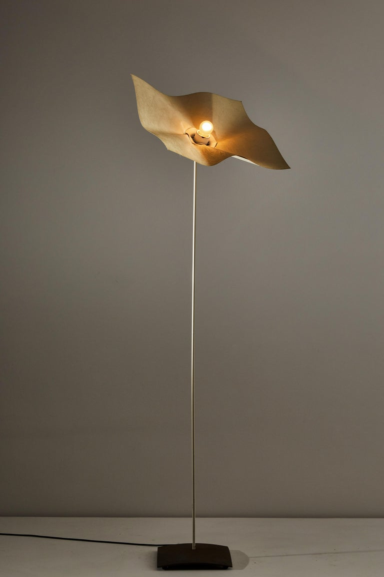 Area curvea floor lamp by Mario Bellini & Giorgio Origlia for Artemide. Designed and manufactured in Italy, 1974. Felt diffuser, metal base. Original cord with step switch. Takes one E27 40w maximum bulb. Bulbs provided as a onetime courtesy.
