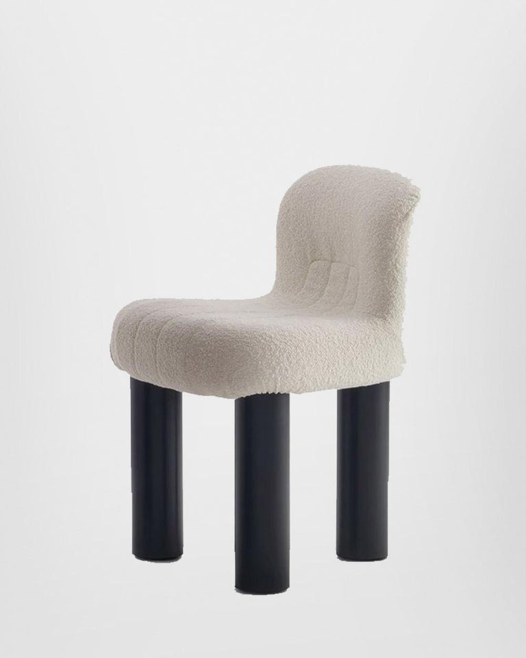 Botolo Chair is designed by Cini Boeri for Arflex. An innovative upholstered rolling chair with three large tubular legs. Botolo is an ideal place to sit, relax and be creative. Cini Boeri designed Botolo in 1973, giving life to a new design style,