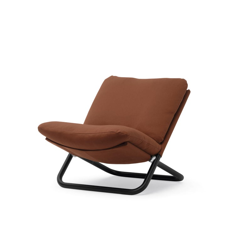 """The seat was born from a very simple idea: two tubes bent into a """"U"""" shape and connected together by a joint.  Additional information: Materials: Upholstered seat with Black Metal Frame Color: Steelcut 2 Col. 655,T4 Structure: Metal, Lacquered"""