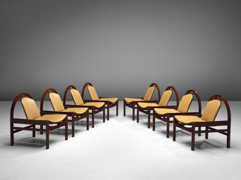 Baumann,'Argos' easy chairs, stained beech, leather, France, 1970s  These 'Argos' lounge chairs were manufactured by Baumann in France in the 1970s. The chairs feature a round frame that supports the tilted backrest. The tilted seat is wide and low