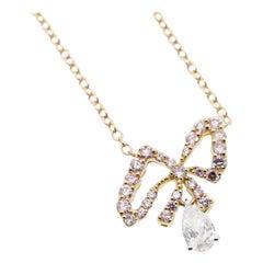 Argyle Pink Diamonds and White Pear Shape Diamonds Bow Pendant Necklace