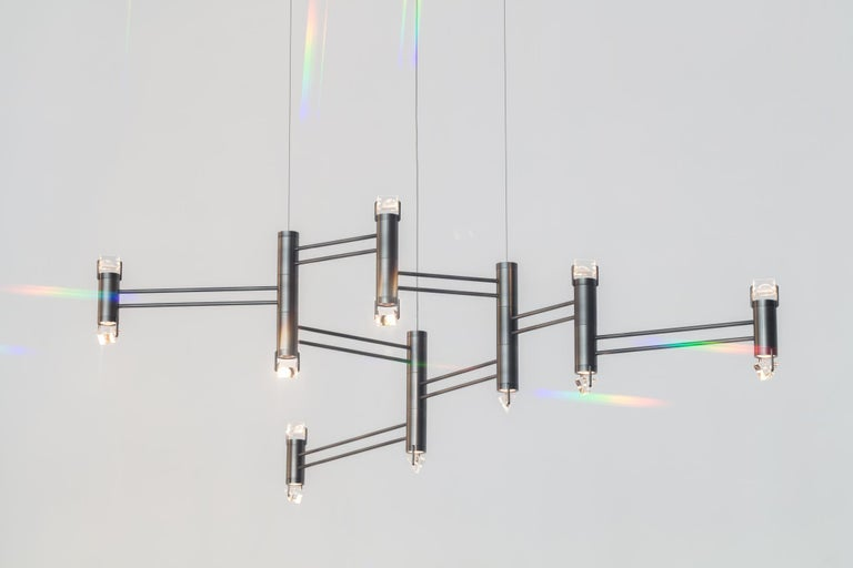 Aries was inspired by the artist Olafur Eliasson's concept and set design for the ballet Tree of Codes where the dancers wore all-black suits highlighted with LEDs. The Polished Nickel stems create a minimal form to position bodies of light topped