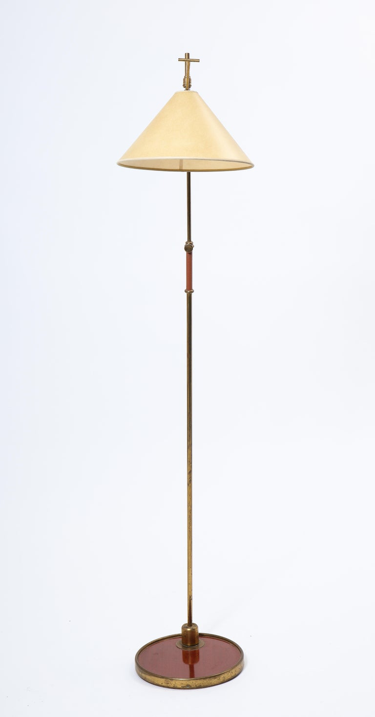 Arlus floor lamp in brass with multiple adjustment, the base is on a large swivel, it goes up and down and the socket is swivel mounted with a directional arm.  Rewire upon request. Shade upon request.