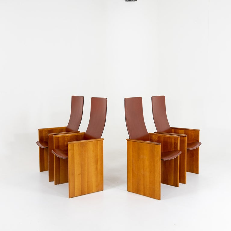 Set of four arm chairs with seats covered in brown leather designed by Afra and Tobia Scarpa for Stildmous 1964.