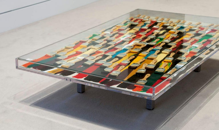 ARMAN Signed Accumulation of brushes and acrylic on canvas in a Plexiglass table Measures: 153 x 100 x 34.5 cm, 60 ¼ x 39 3/8 x 13 9/16 in.   Arman is a painter who moved from using objects for the ink or paint traces they leave to using them